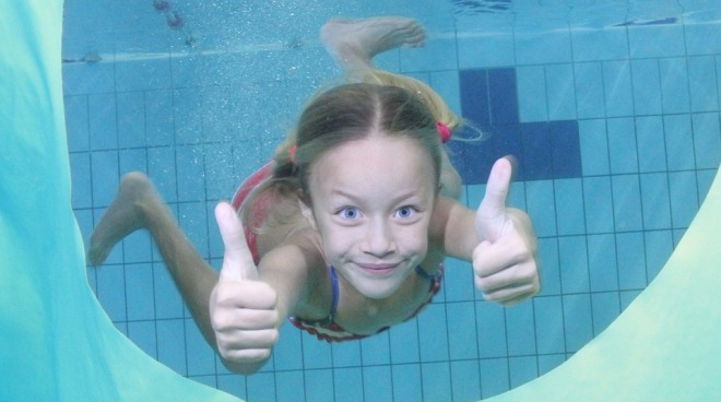 girl swimming thumbs up